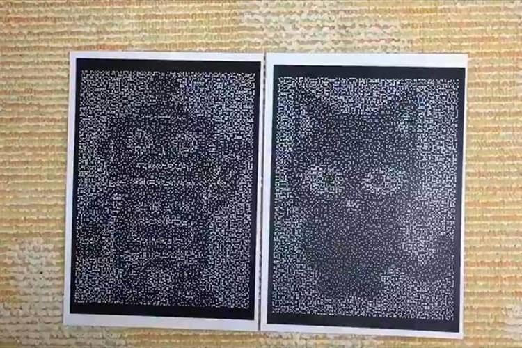 これは不思議!ロボットと猫の切り絵を重ねると、予想外の絵柄が浮かび上がった!
