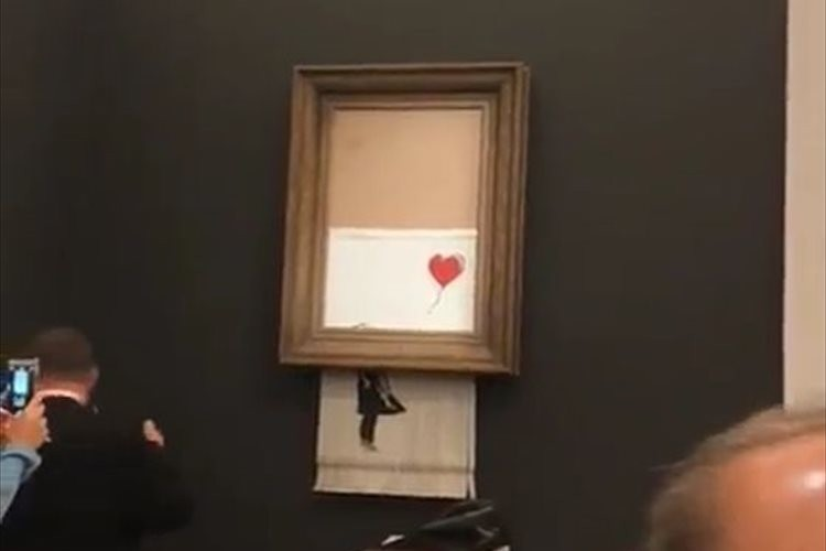 「自滅までが作品!?」140万ドルで落札された絵画が、落札された直後にシュレッダーされる